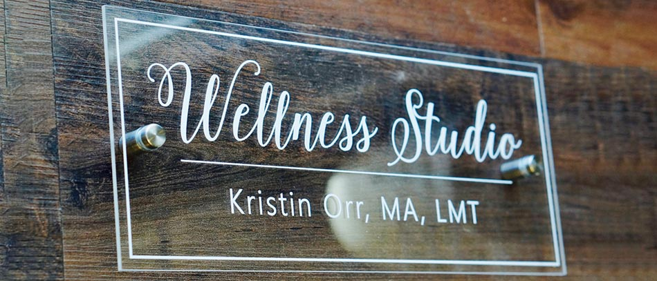 Wellness Studio wood sign with vinyl lettering