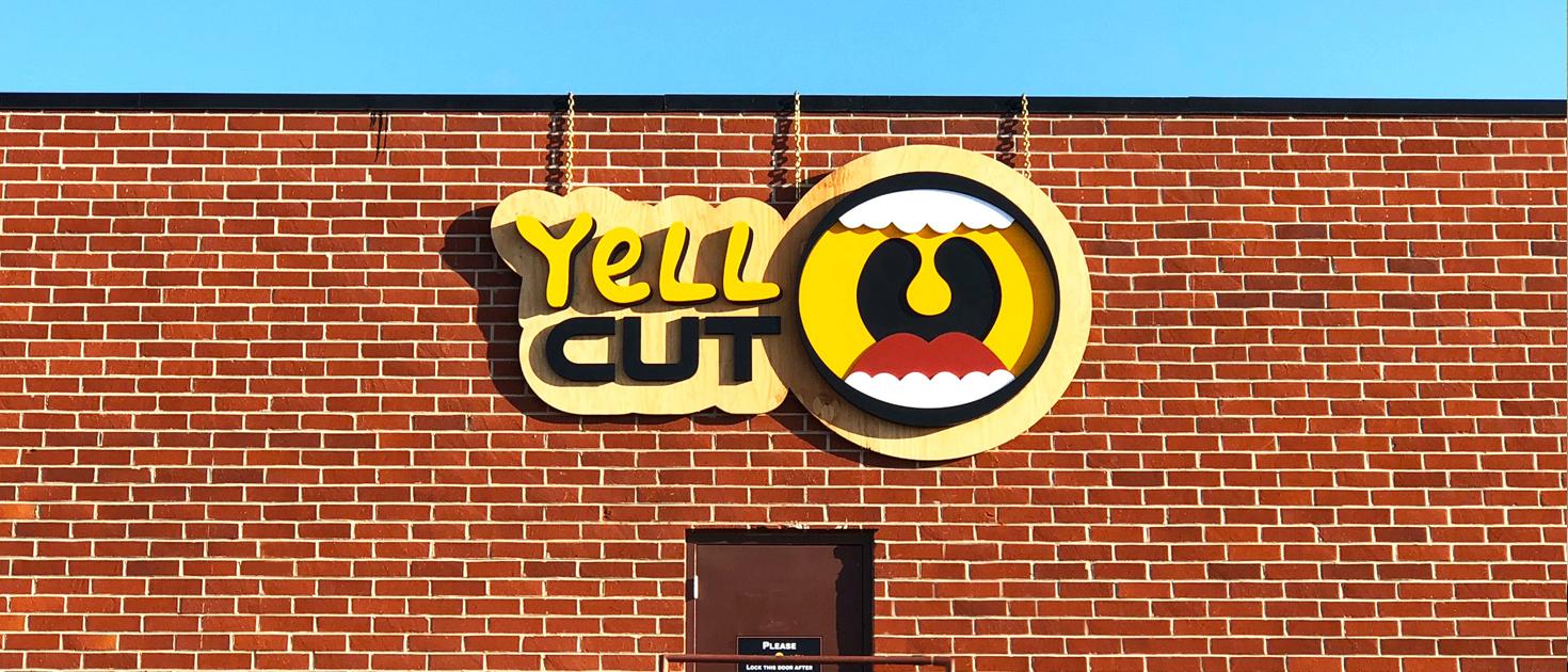 yell cut wooden logo sign