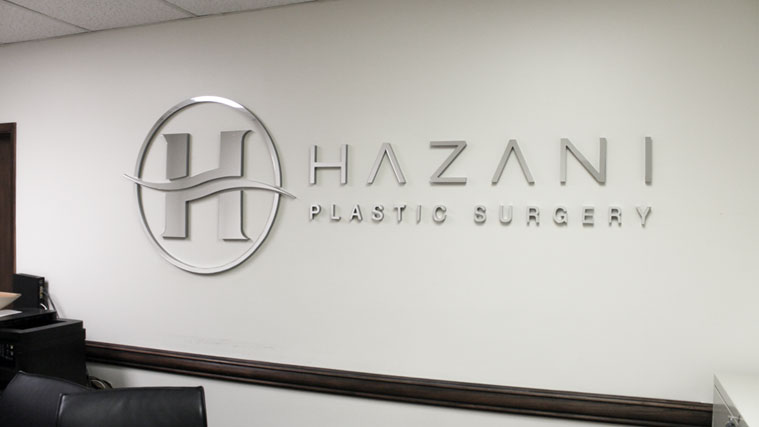 PVC and Acrylic Sign with the name and the logo of Hazani