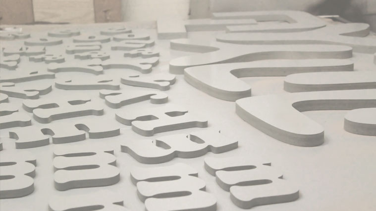 In-house made PVC letters with a white coat of paint