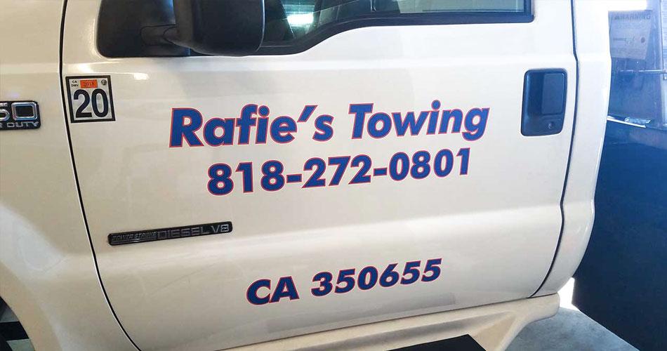 Rafie's Towing car door vinyl lettering