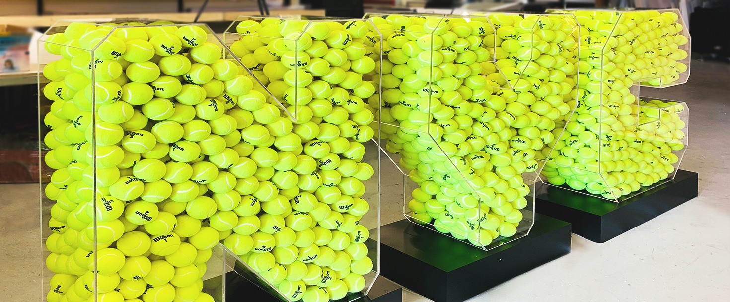 NYC custom 3d sign in a large size made of clear acrylic and filled with tennis balls