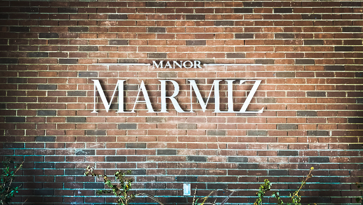 Manor Marmiz aluminum 3d letters displaying the company name on a brick wall