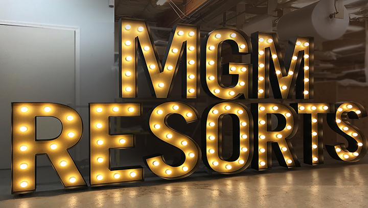 MGM Resorts marquee lighted sign in a big size displaying the brand name made of aluminum