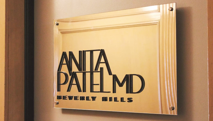 Anita Patel MD office nameplate displaying the person's name and position made of acrylic