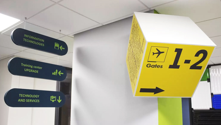 custom office wayfinding signs in yellow and dark blue colors made of PVC and opaque vinyl