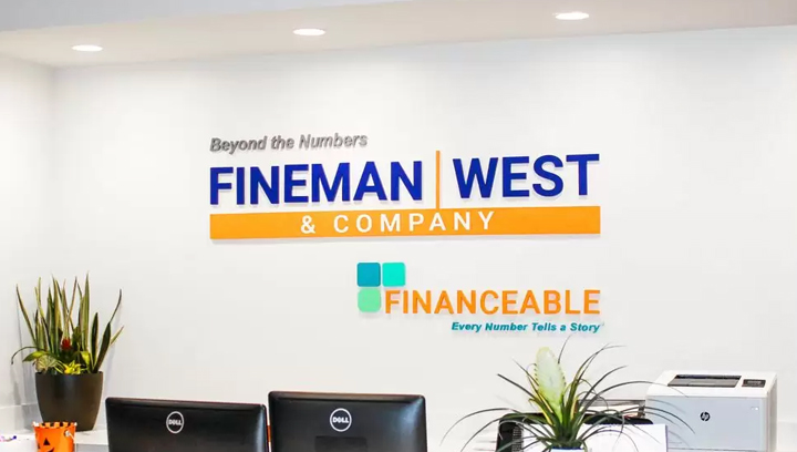 Fineman & West Company office reception sign with the company name and logo made of acrylic