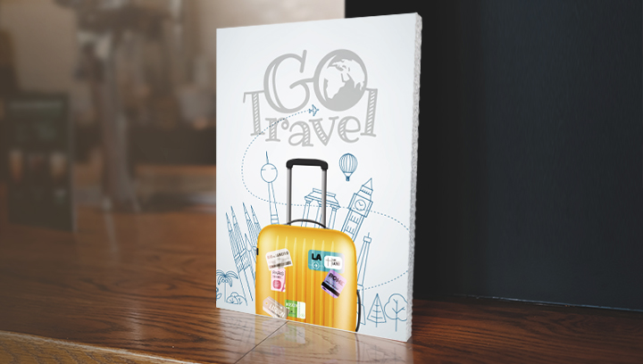 easel back foam core sign with travel theme graphics displayed on the table