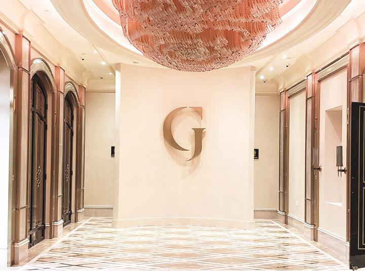 Grand Venue lobby logo sign in golden color made of aluminum for interior branding