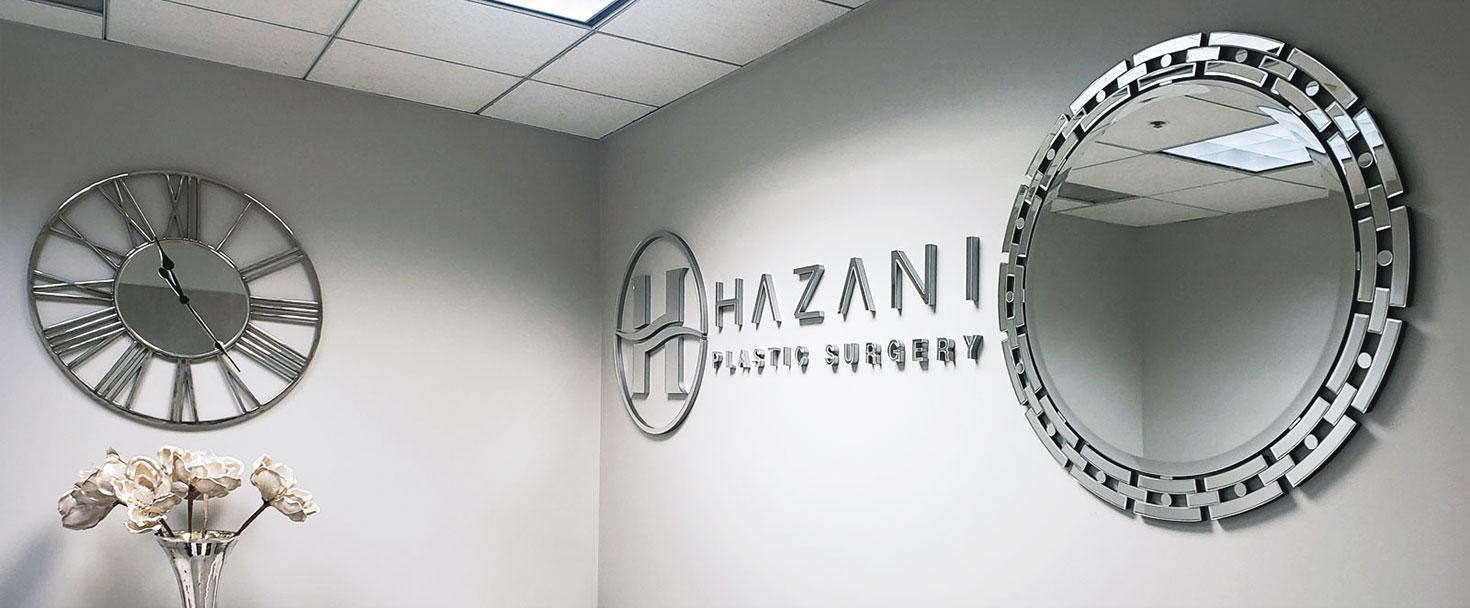 Hazani Plastic Surgery acrylic lobby sign displaying the company name and logo