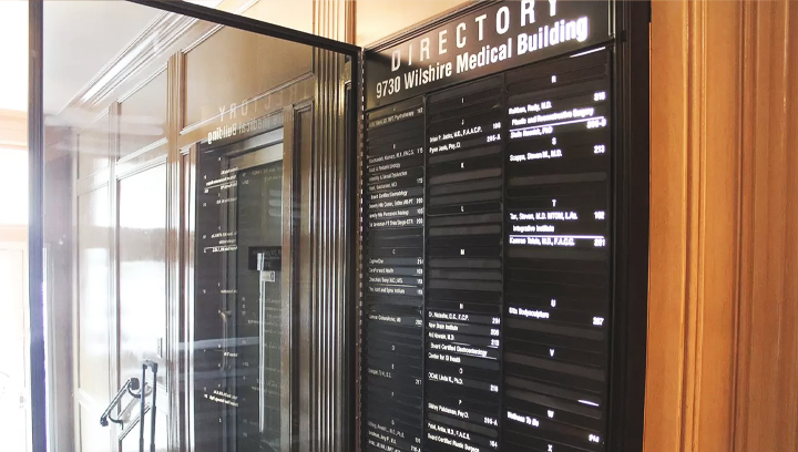 Interior office directory sign displaying business services for advertising