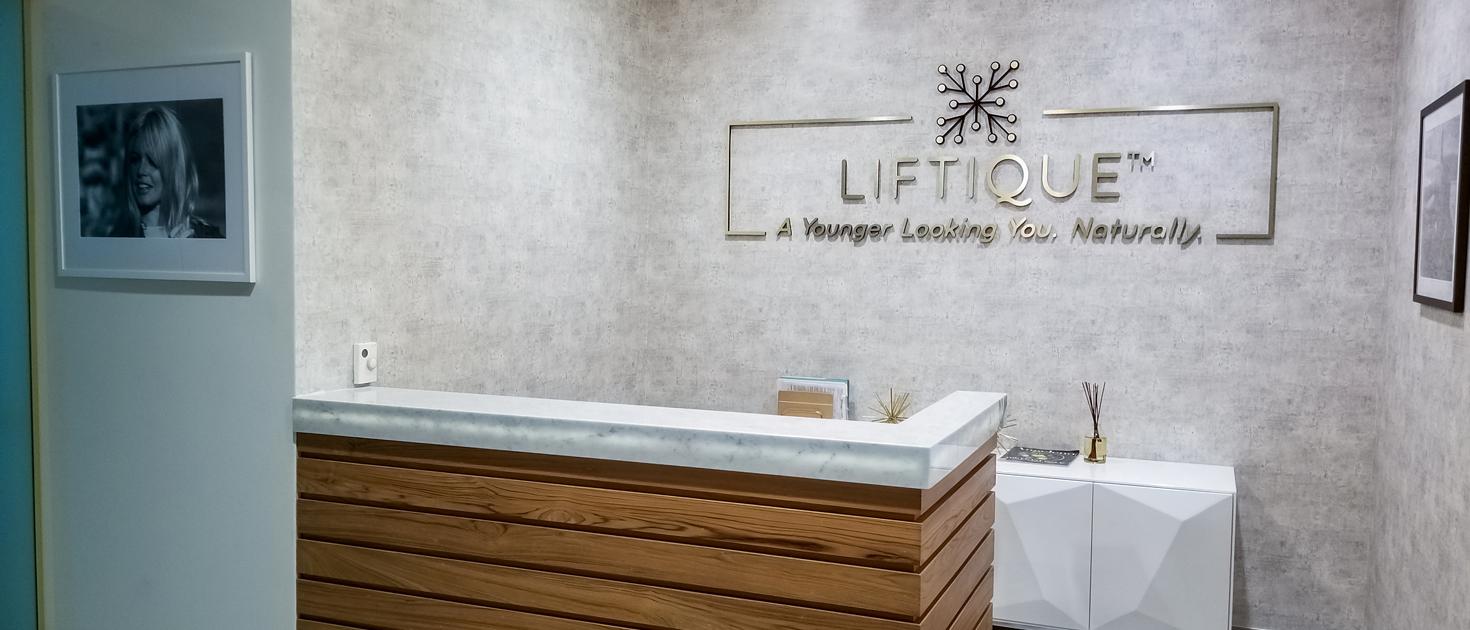 Liftique reception sign