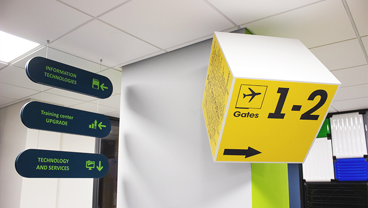 Ameriabank wayfinding lobby signs in yellow and dark blue made of PVC and opaque vinyl