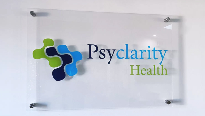 Psyclarity Health plastic office sign displaying the company name and logo made of acrylic
