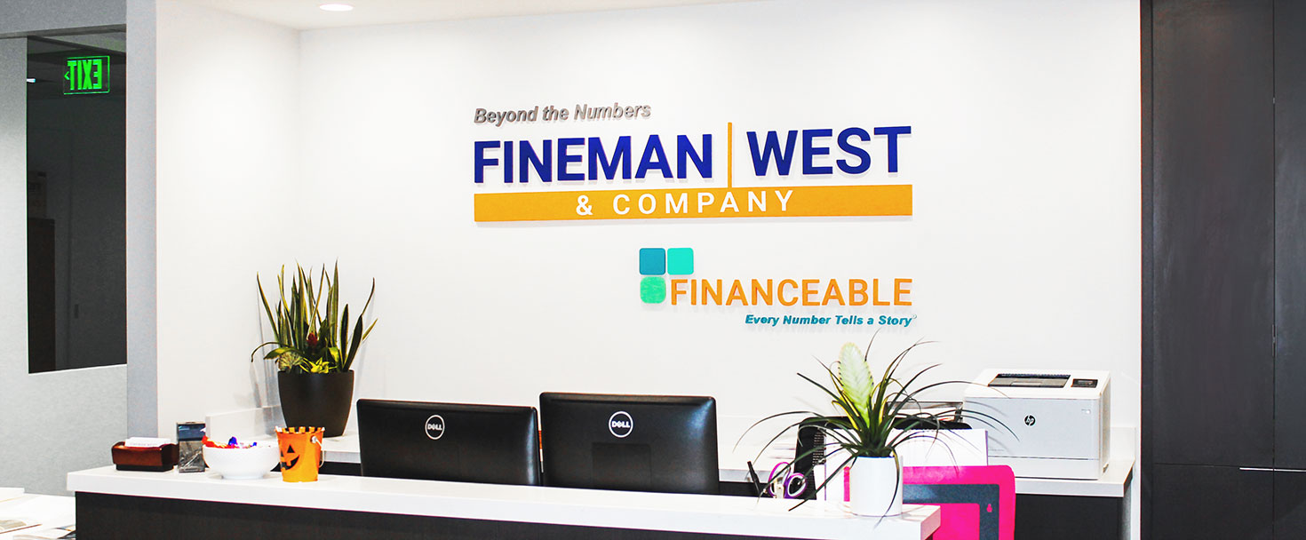 Fineman & West Company reception logo sign made of acrylic for interior branding