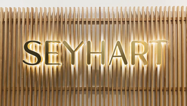 Seyhart illuminated office sign displaying the company name made of aluminum and acrylic