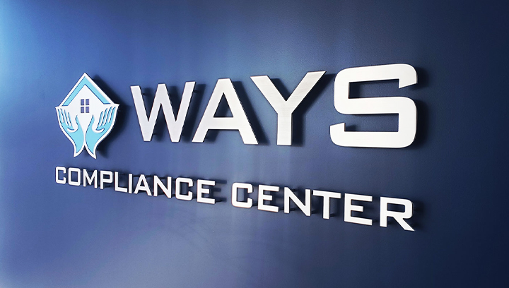 Ways Compliance Center aluminum lobby sign displaying the company name and logo