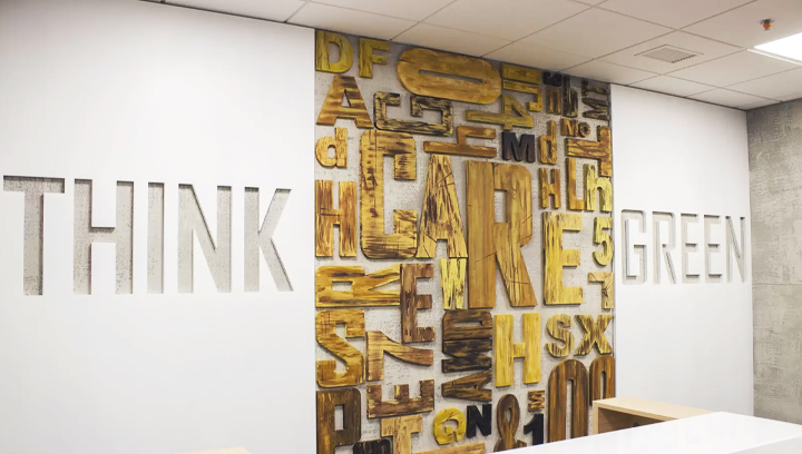 Ameriabank wooden office sign with custom cut letters for reception area design