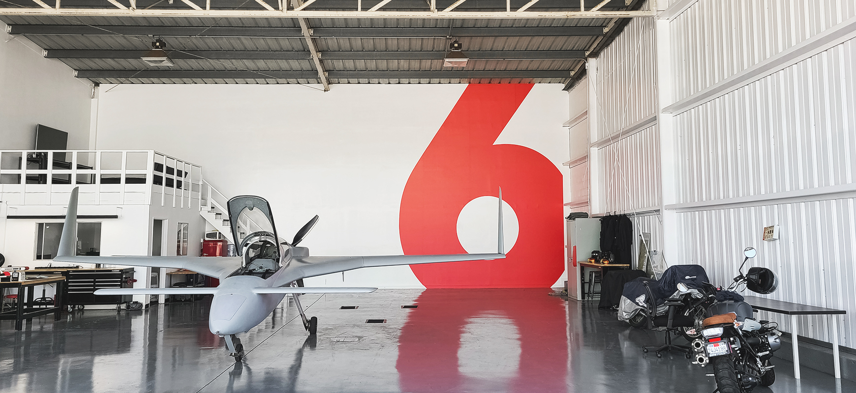 Airplane Hangar vinyl decal in red displaying the number six made of opaque vinyl