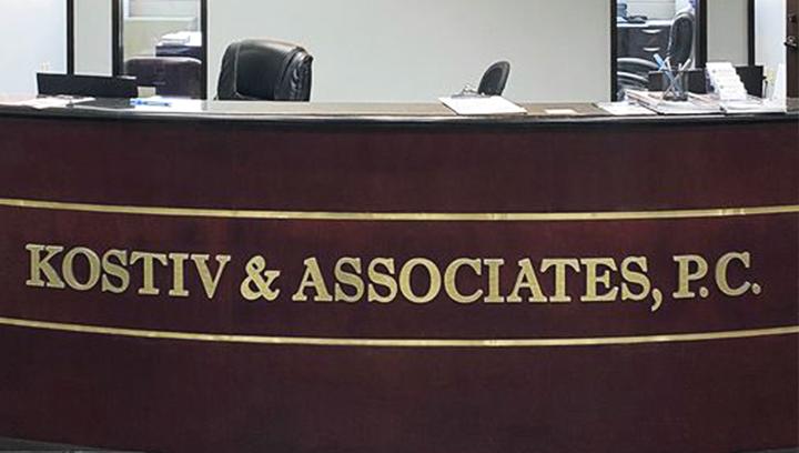 Kostiv & Associates office backlit foam core sign made of ultra board for reception branding