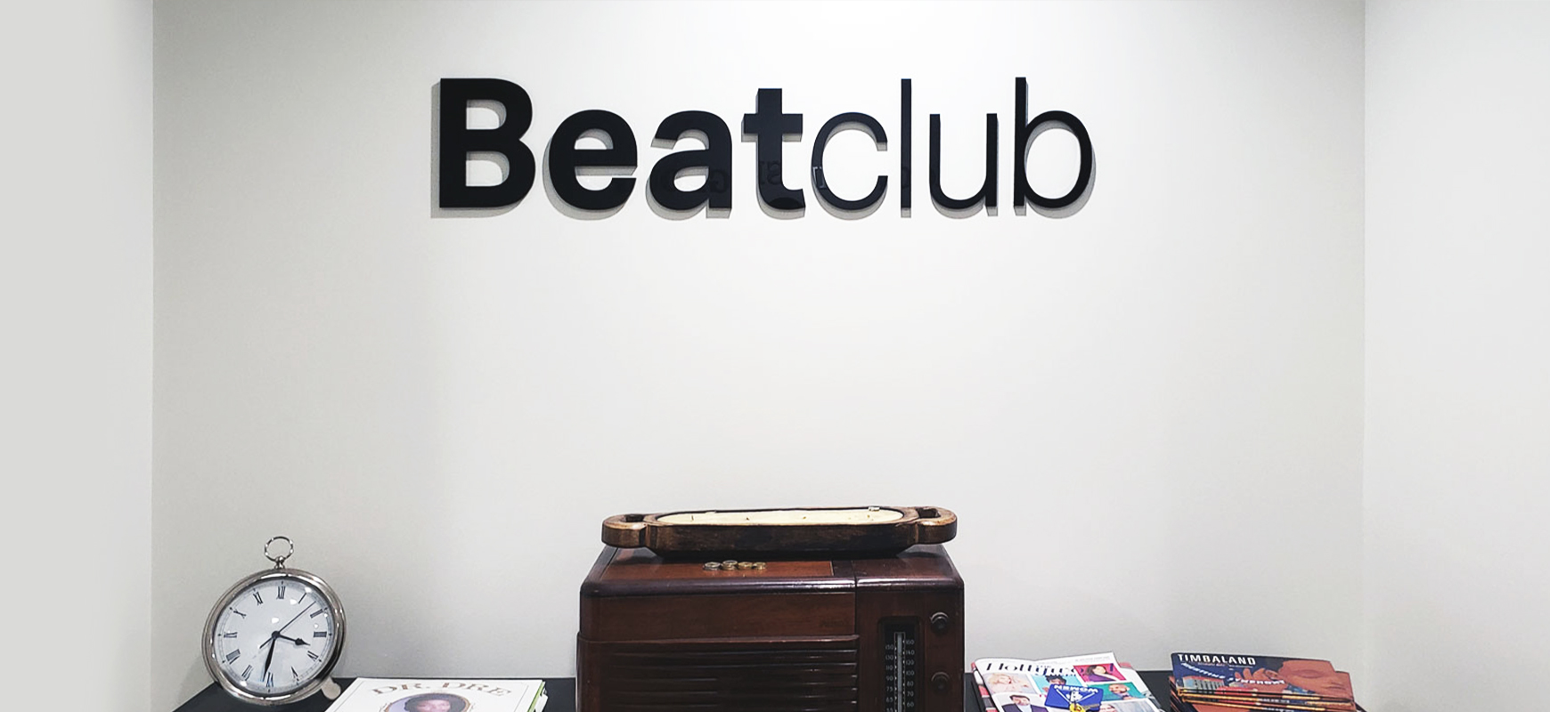 Beatclub office signage in black color displaying brand name 3D letters made of acrylic