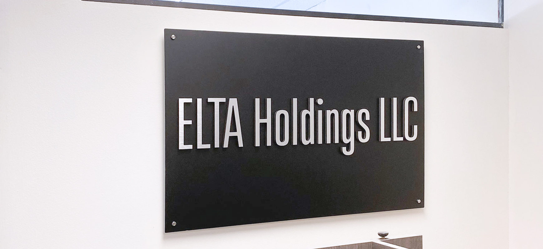 Elta Holdings LLC foam core sign with brushed brand name 3d letters made of ultra board