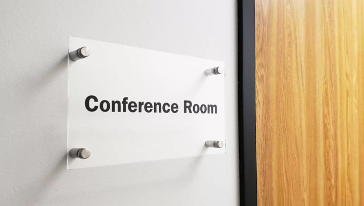 Conference room lobby plaque made of acrylic and installed with metallic standoffs