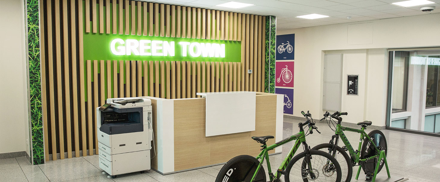 Ameriabank custom lobby signs with a green theme made of acrylic and wood for interior design