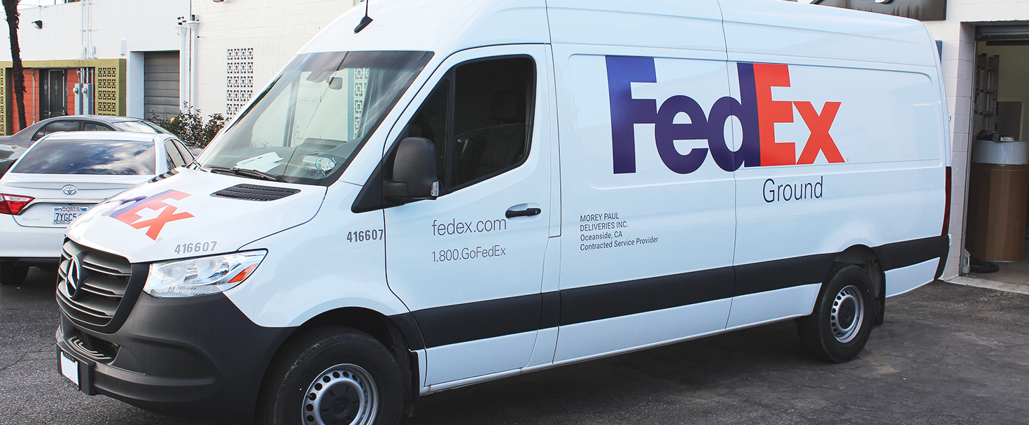 FedEx business decals displaying the brand name made of opaque vinyl applied to the car
