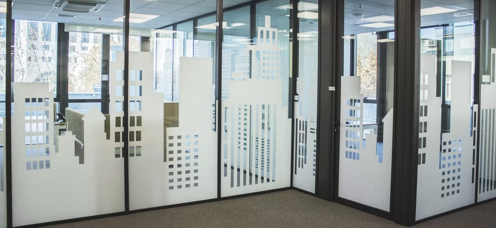 decorative office signs displaying building graphics made of frosted vinyl for window design
