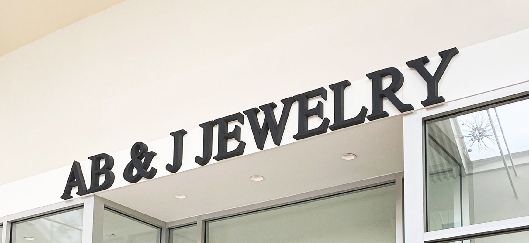 Ab & J Jewelry foam board sign with brand name 3d letters for storefront branding