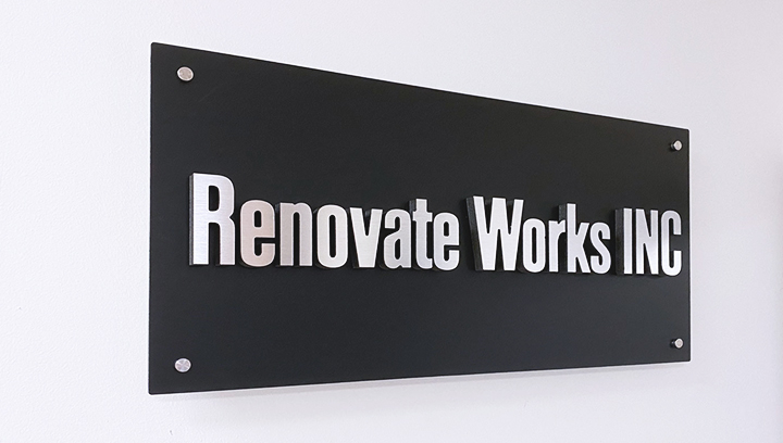 Renovate Works Inc. foam core lobby sign in black with brand name 3d letters