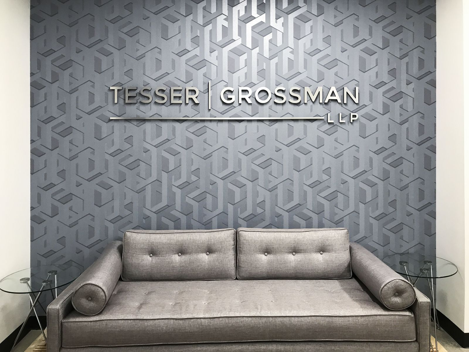 Tesser Grossman LLP 3d sign letters with a silver brushed finish made of ultraboard for lobby branding