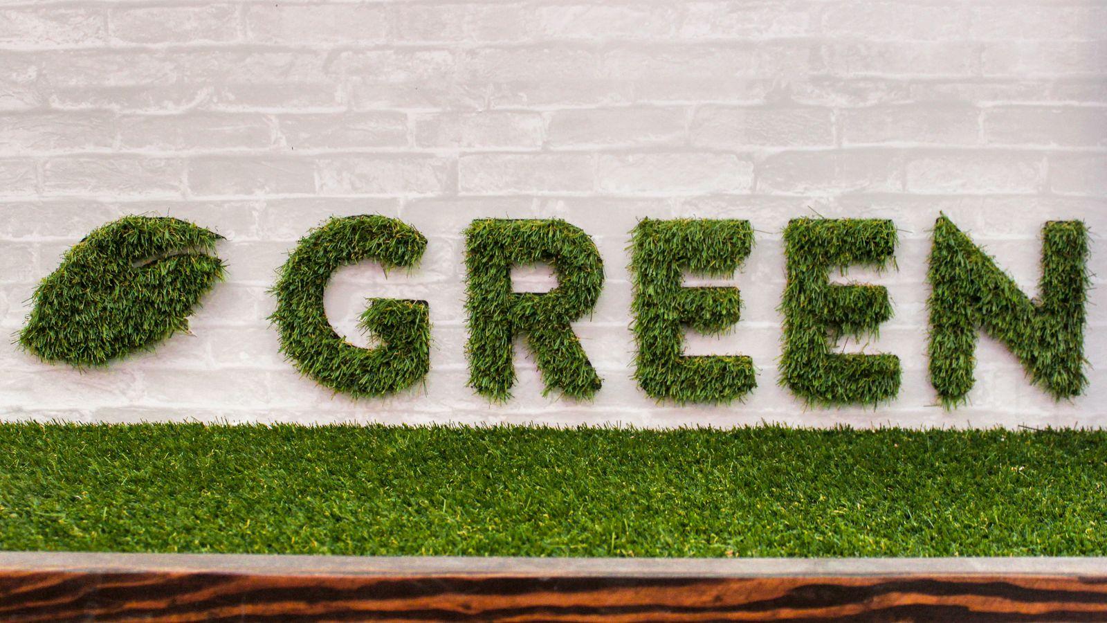 Artificial grass sign