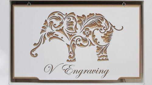 Elephant engraved on wood