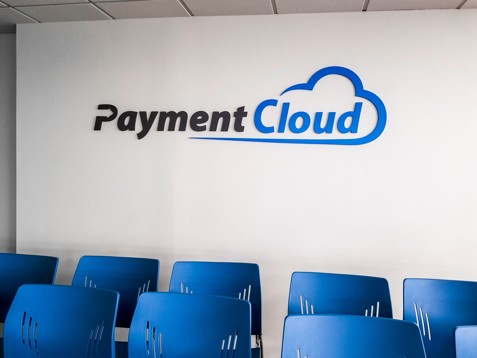 Payment Cloud interior dimensional signage with the company name and logo custom-made of acrylic for indoor branding