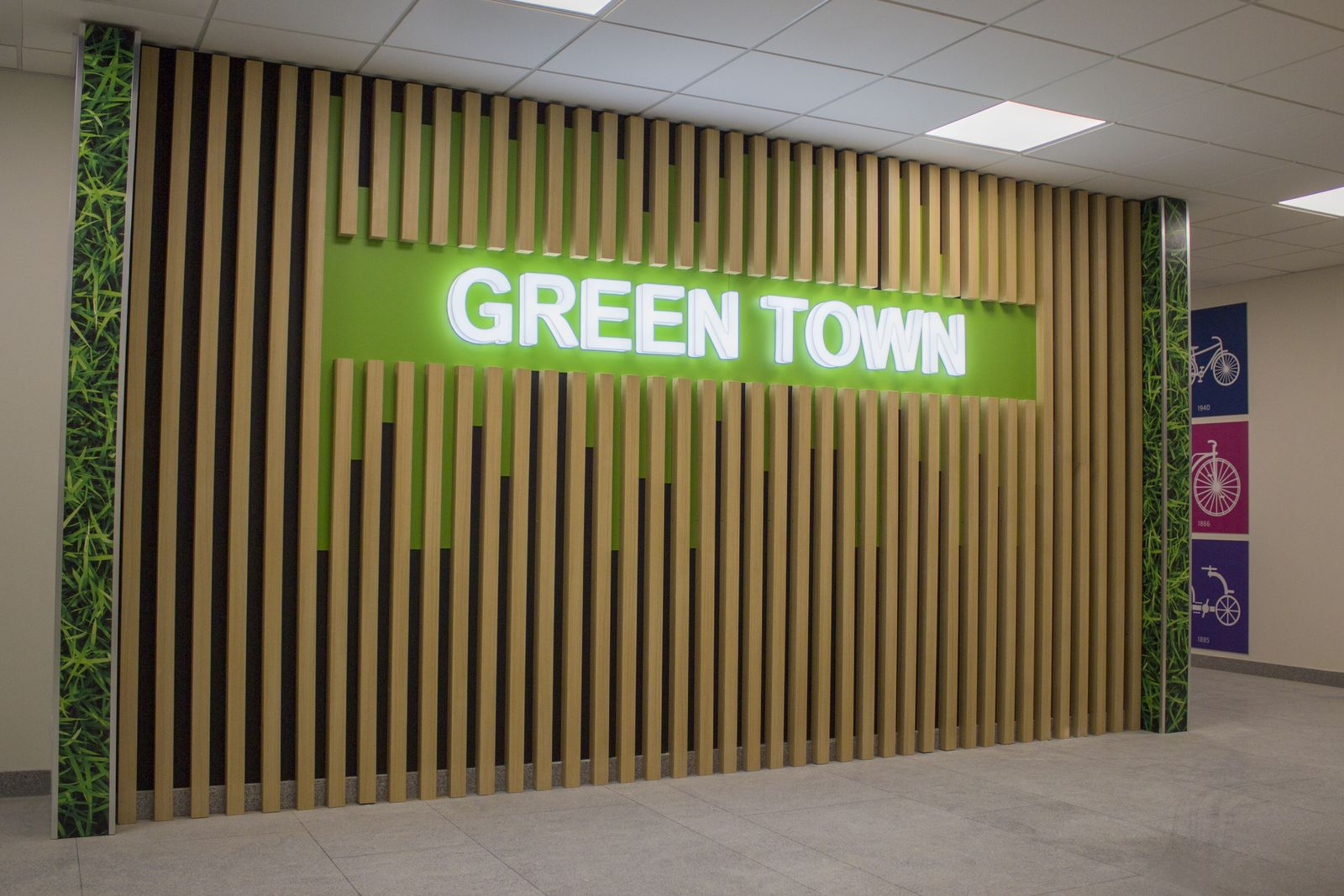 Ameriabank illuminated interior signage with Green Town text and custom plaques made of wood