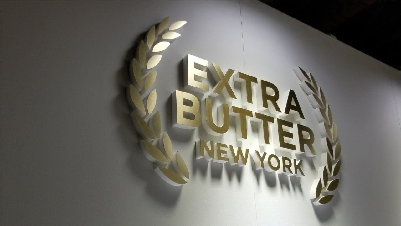 Extra Butter New York interior business sign with the company name and logo made of ultraboard for shoe store branding