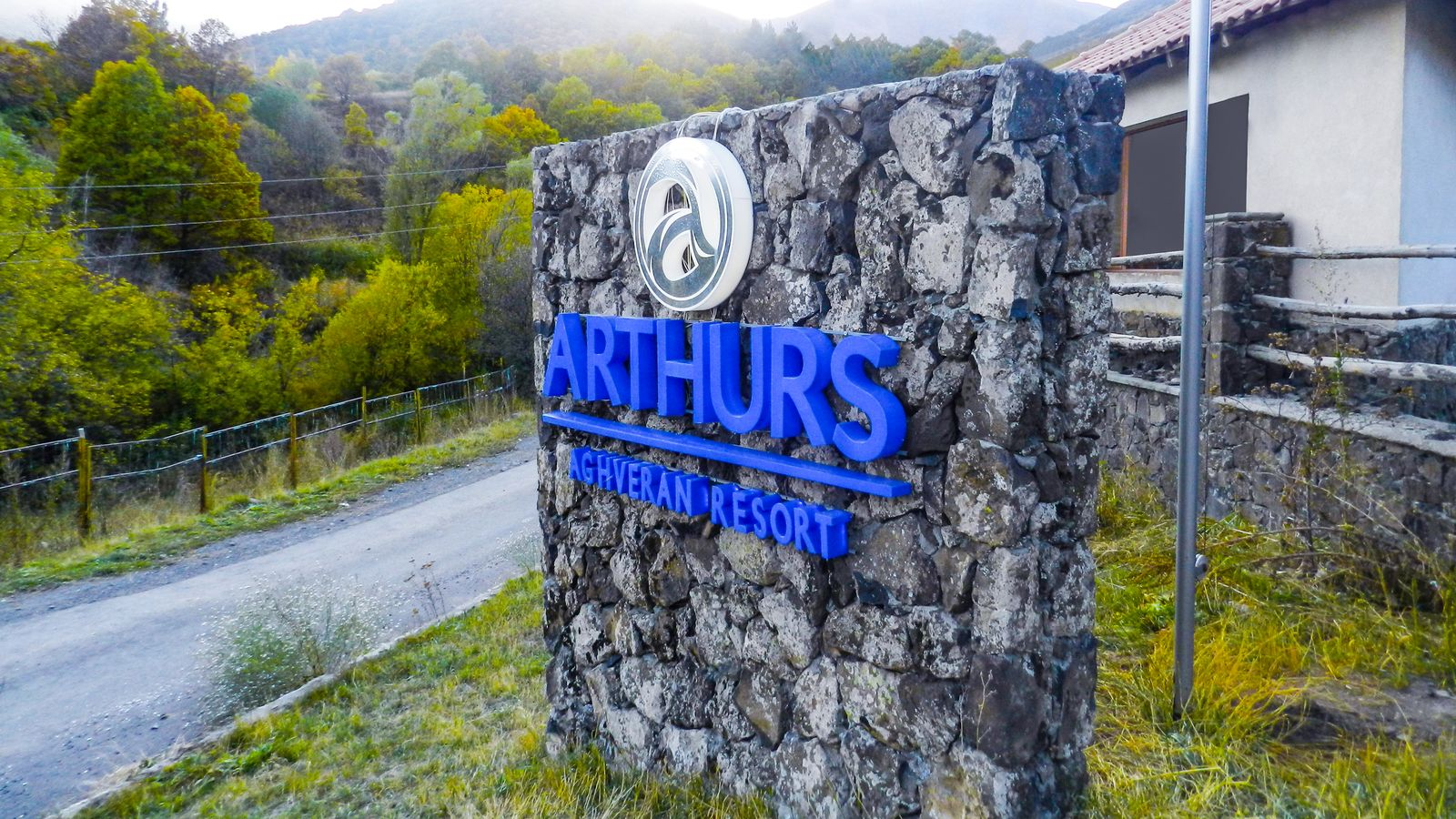 Arthurs Aghveran Resort 3d acrylic letters and logo fixed on a stone wall for business exterior branding