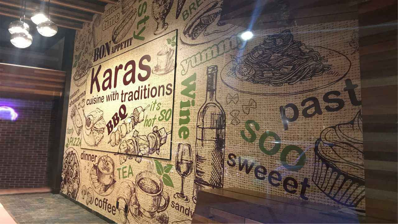 Karas custom interior wall sign with food and drink names and images made of opaque vinyl for restaurant indoor design