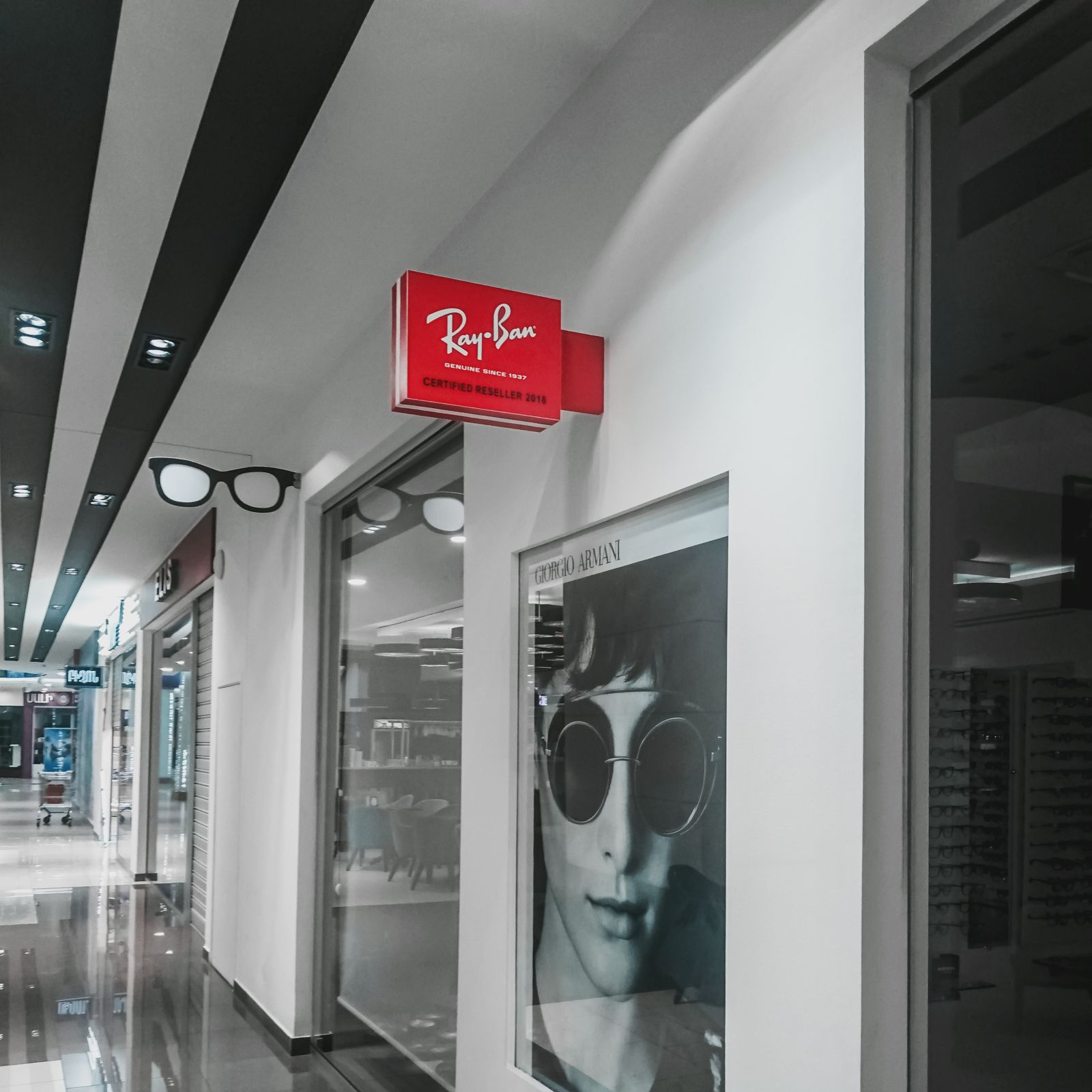 Ray Ban acrylic light box in red color and wall-blade style for store branding and promotion inside a shopping mall