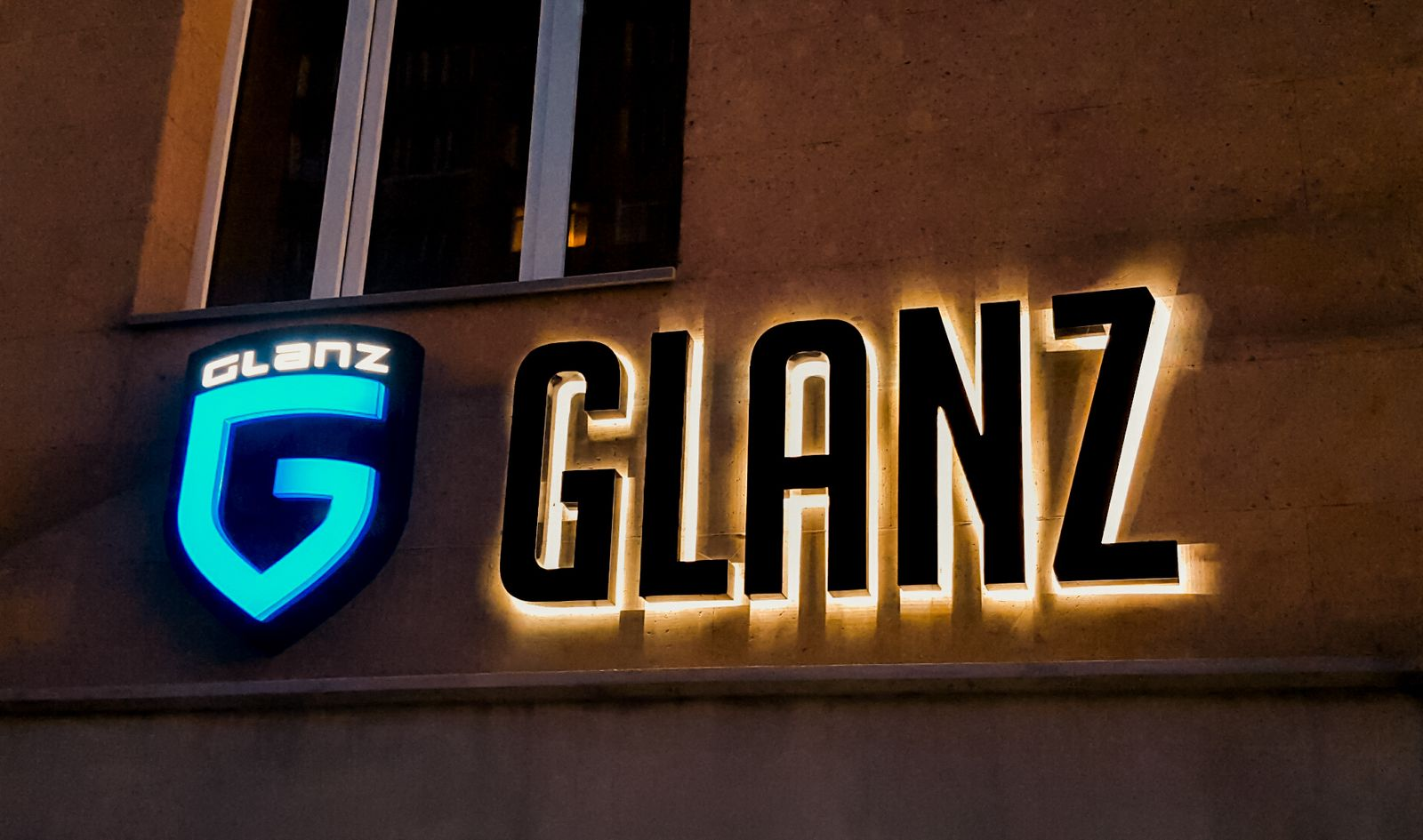 Reverse lit channel letters for an outdoor logo sign