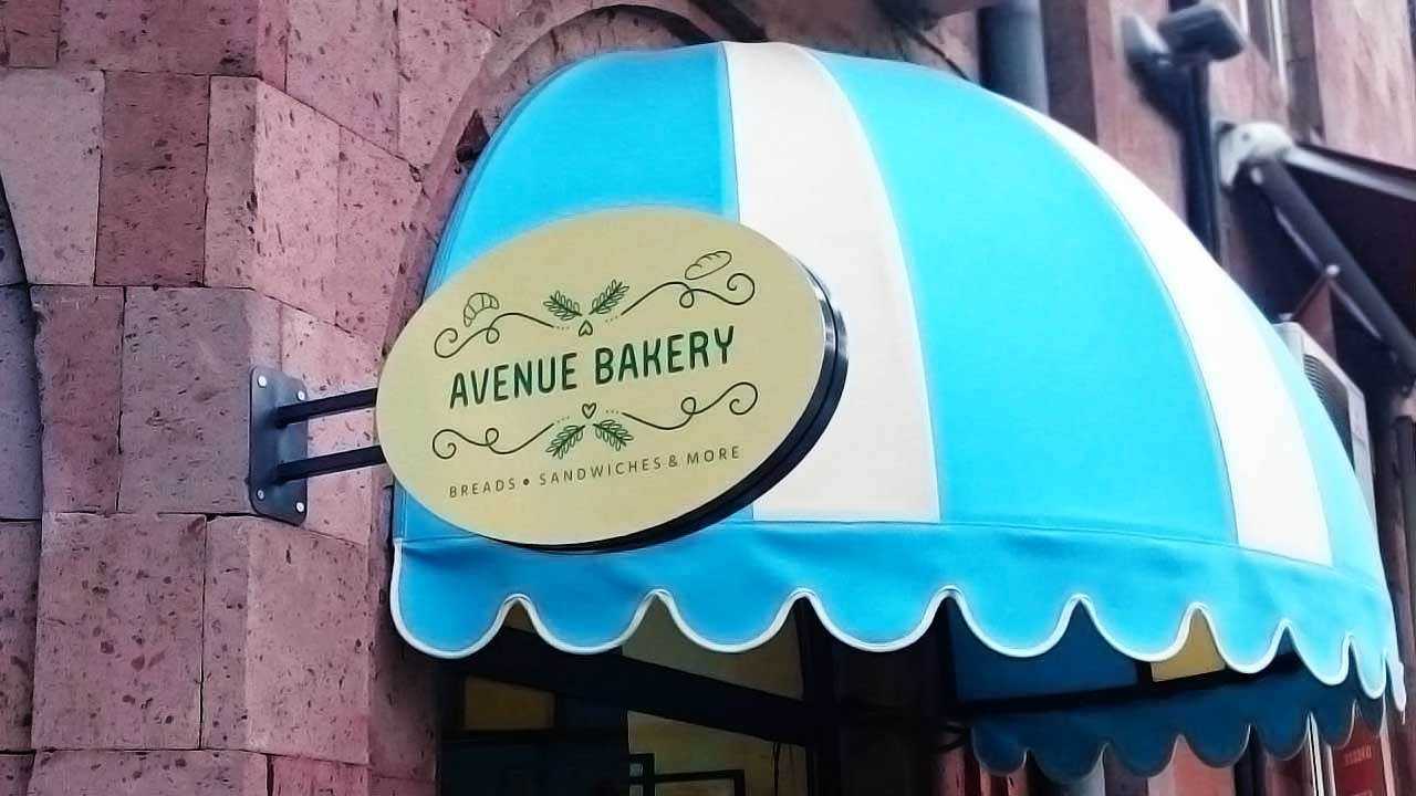 Avenue Bakery custom light box in an oval shape made of aluminum and acrylic for branding