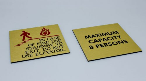 brushed aluminum warning signs