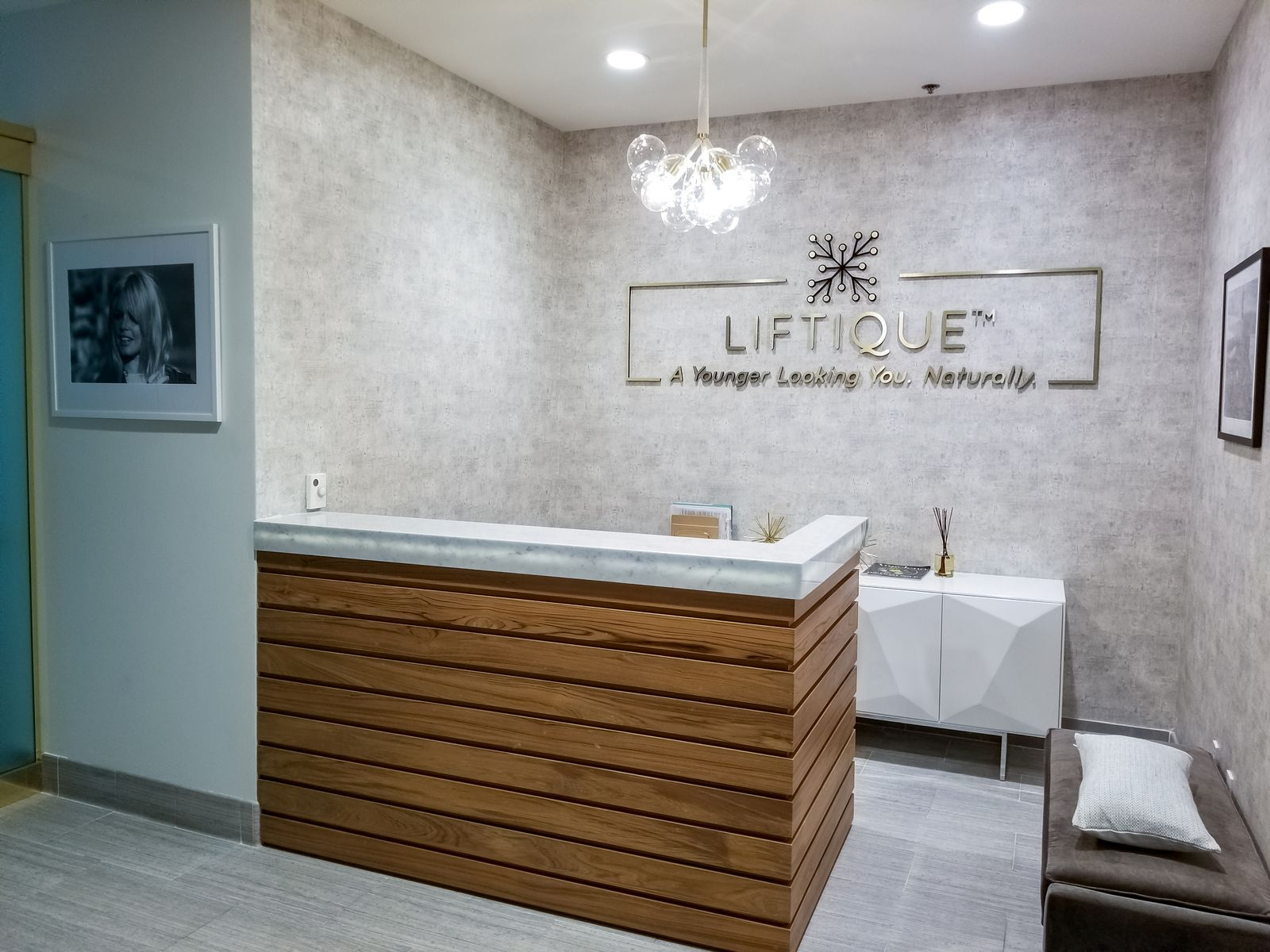 Liftique Clinic reception logo sign and slogan made of aluminum and acrylic