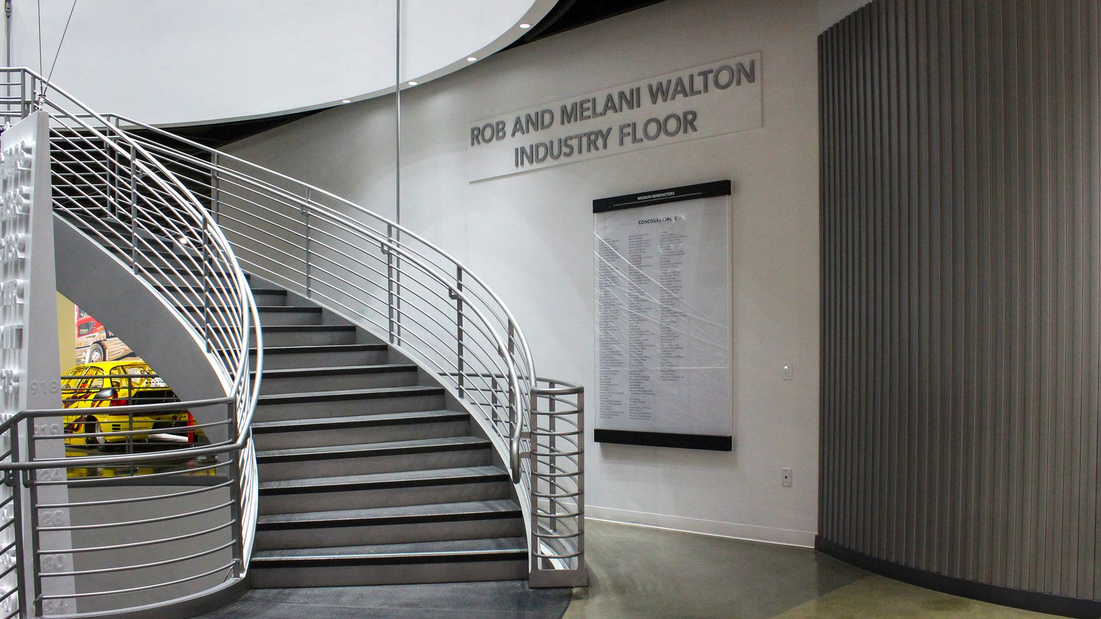 Rob and Melani Walton interior signage with museum benefactors names made of acrylic, aluminum and frosted vinyl for branding