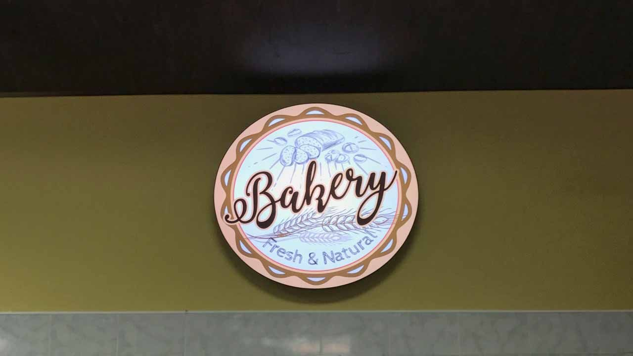 Bakery LED light box with thematic graphics made of aluminum and covered with acrylic and backlit vinyl for interior branding
