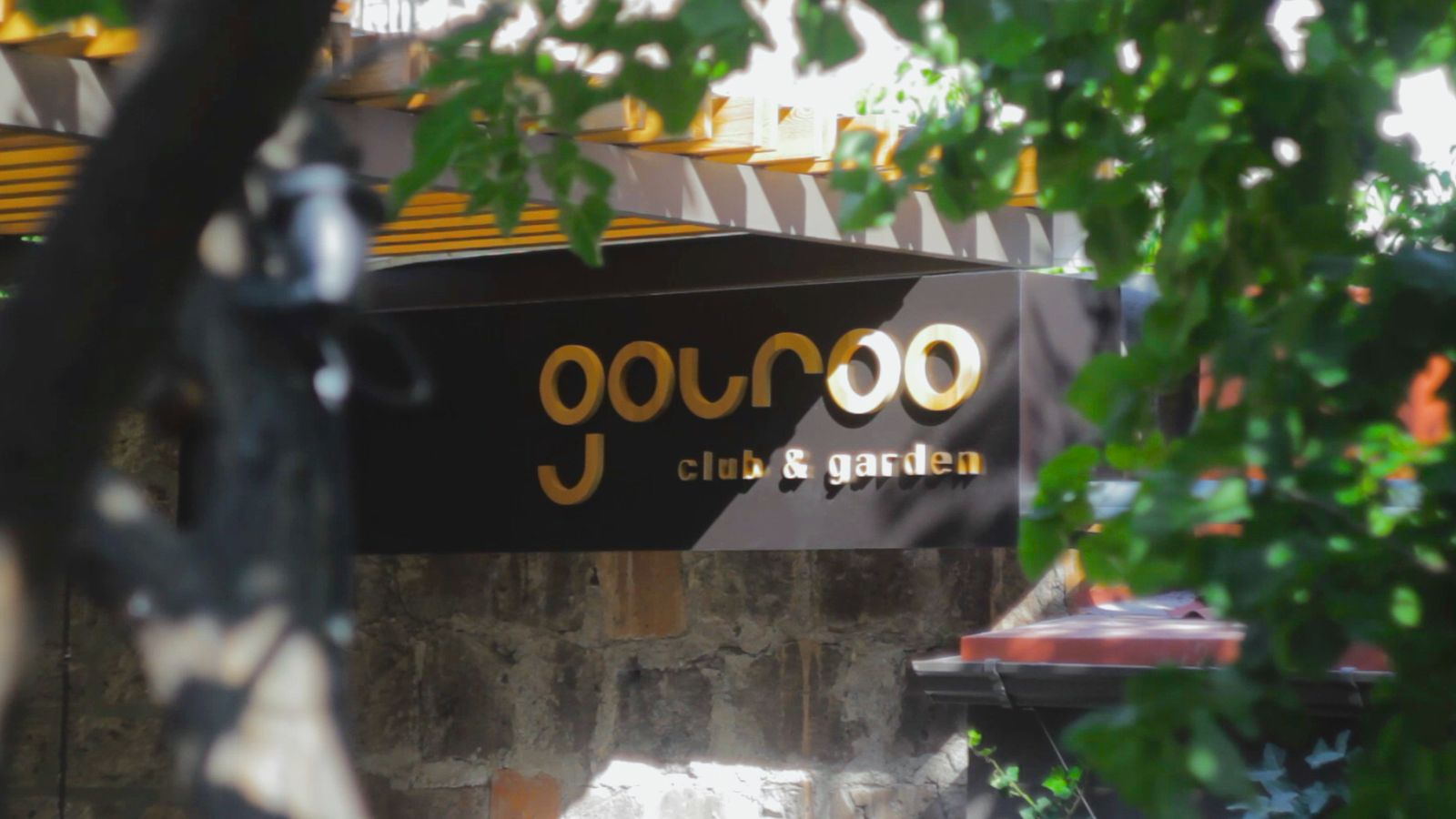 Gouroo Club & Garden 3d sign with a black background made of acrylic and aluminum for restaurant branding