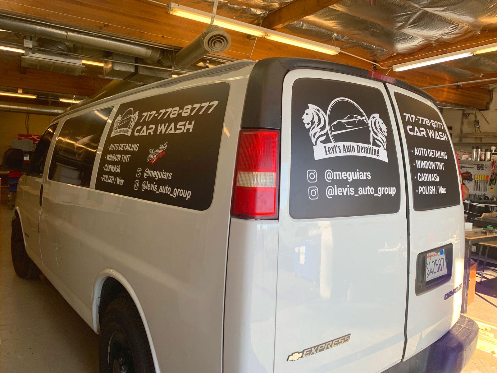 White van with black window wraps