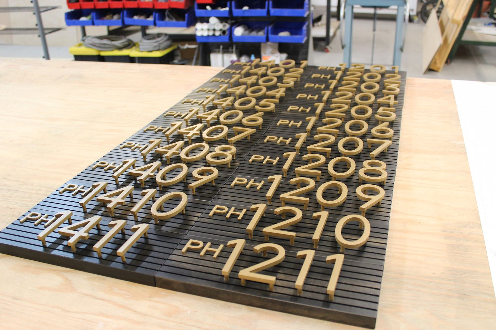 3d metal letters and address numbers sign with a board made of aluminum and wood